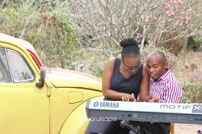 Kenyan destination wedding engagement session in a car yard in the wild by waruisapix-10