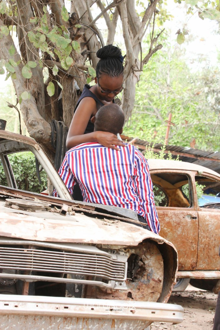 Kenyan destination wedding engagement session in a car yard in the wild by waruisapix-17