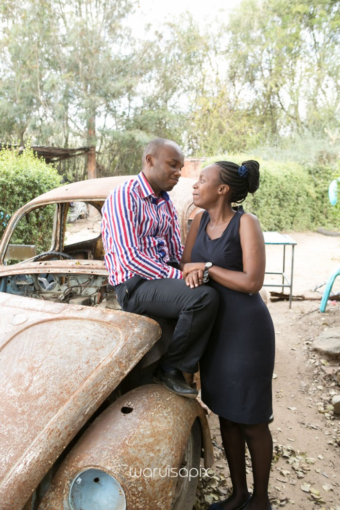 Kenyan destination wedding engagement session in a car yard in the wild by waruisapix-19