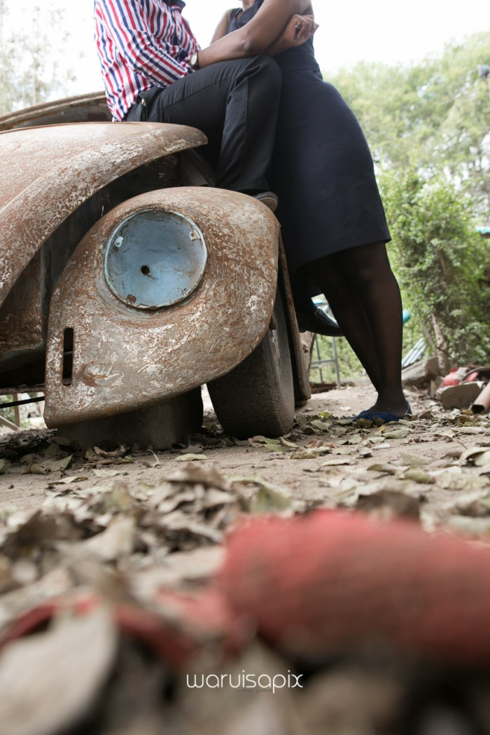 Kenyan destination wedding engagement session in a car yard in the wild by waruisapix-20