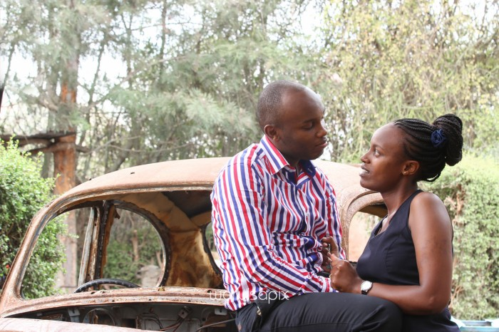 Kenyan destination wedding engagement session in a car yard in the wild by waruisapix-22
