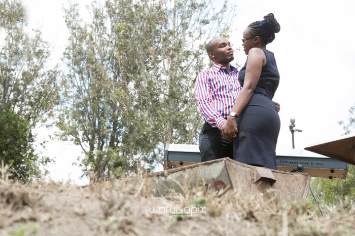 Kenyan destination wedding engagement session in a car yard in the wild by waruisapix-25
