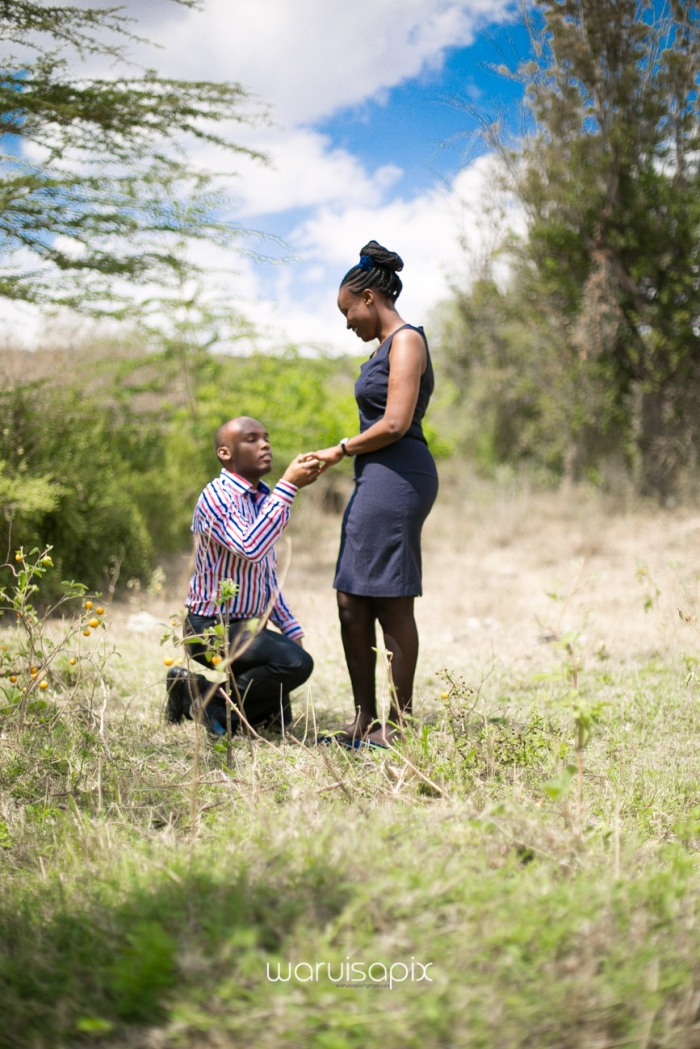 Kenyan destination wedding engagement session in a car yard in the wild by waruisapix-30