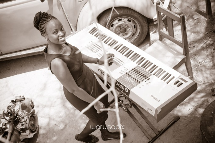 Kenyan destination wedding engagement session in a car yard in the wild by waruisapix-3