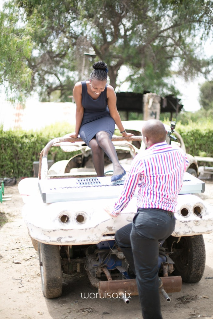 Kenyan destination wedding engagement session in a car yard in the wild by waruisapix-36