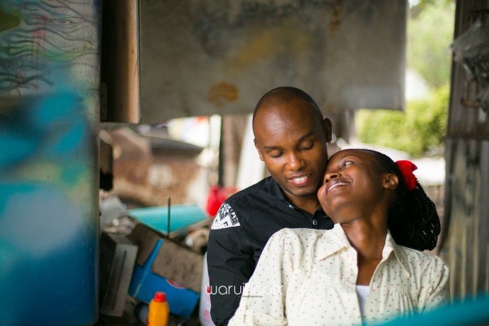 Kenyan destination wedding engagement session in a car yard in the wild by waruisapix-51
