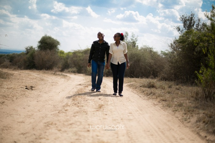 Kenyan destination wedding engagement session in a car yard in the wild by waruisapix-55