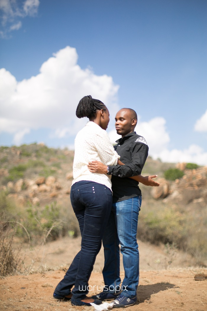 Kenyan destination wedding engagement session in a car yard in the wild by waruisapix-58
