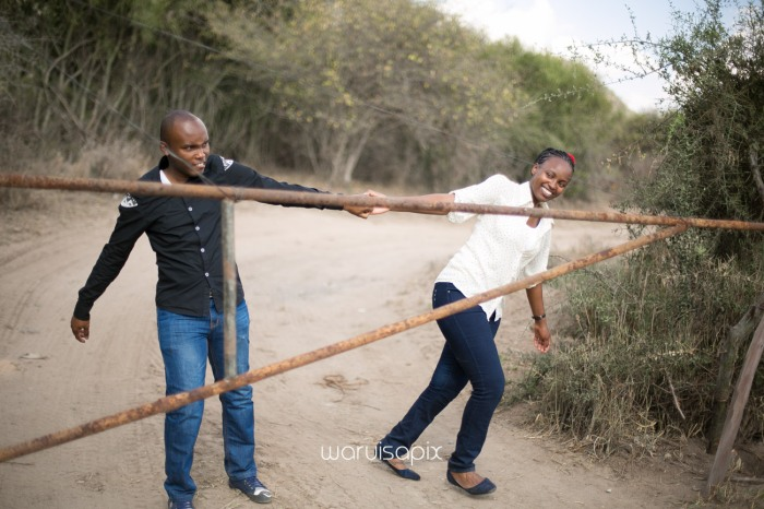 Kenyan destination wedding engagement session in a car yard in the wild by waruisapix-65