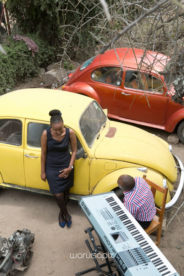 Kenyan destination wedding engagement session in a car yard in the wild by waruisapix-6
