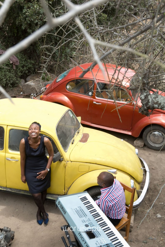 Kenyan destination wedding engagement session in a car yard in the wild by waruisapix-7