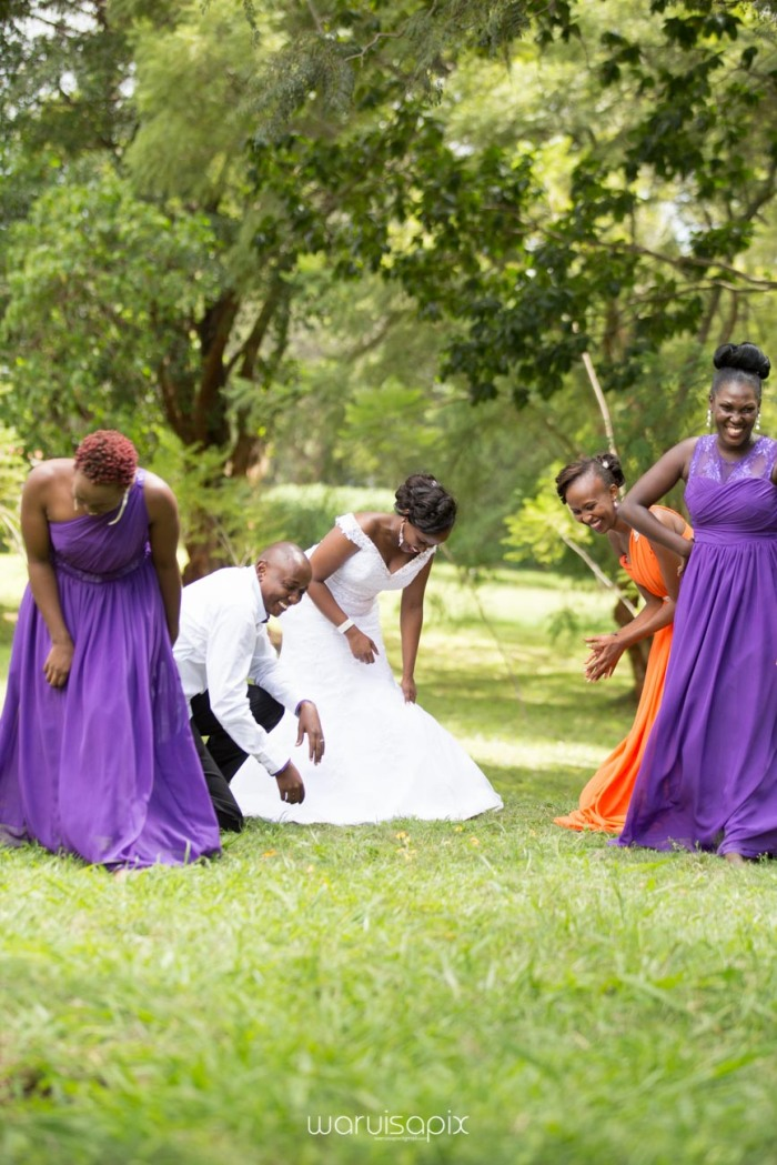 wedding photoshoot on a Helipad on top of nairobi's tallest building KICC with the skyline in view and sunset by waruisapix top kenyan wedding photographer-114