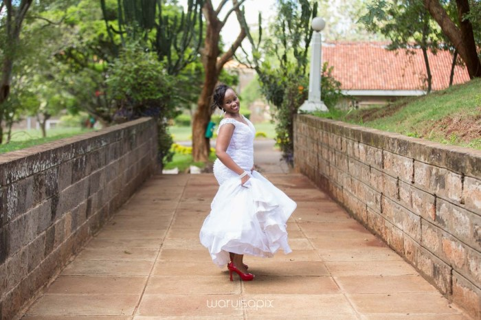 wedding photoshoot on a Helipad on top of nairobi's tallest building KICC with the skyline in view and sunset by waruisapix top kenyan wedding photographer-123
