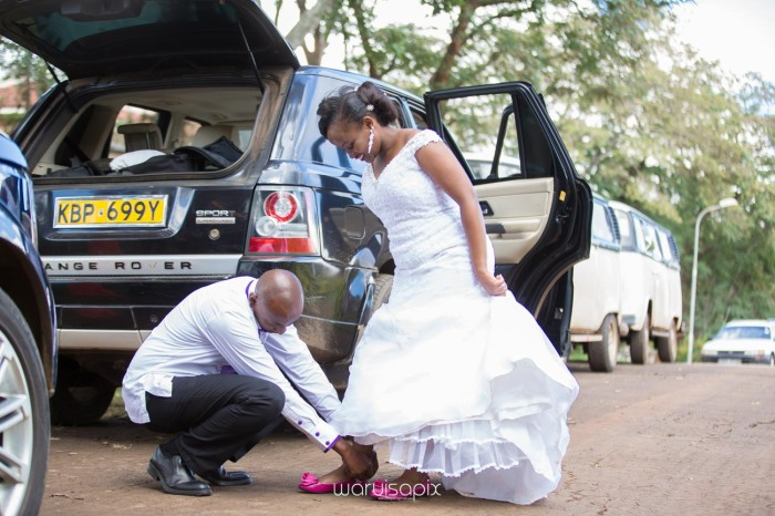 wedding photoshoot on a Helipad on top of nairobi's tallest building KICC with the skyline in view and sunset by waruisapix top kenyan wedding photographer-124