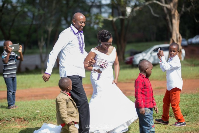 wedding photoshoot on a Helipad on top of nairobi's tallest building KICC with the skyline in view and sunset by waruisapix top kenyan wedding photographer-127