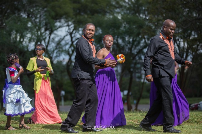 wedding photoshoot on a Helipad on top of nairobi's tallest building KICC with the skyline in view and sunset by waruisapix top kenyan wedding photographer-128