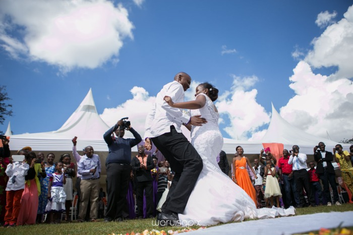 wedding photoshoot on a Helipad on top of nairobi's tallest building KICC with the skyline in view and sunset by waruisapix top kenyan wedding photographer-144