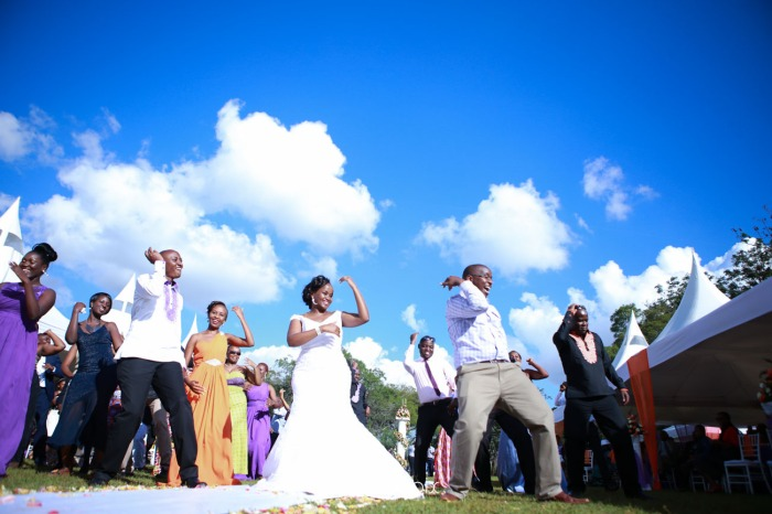wedding photoshoot on a Helipad on top of nairobi's tallest building KICC with the skyline in view and sunset by waruisapix top kenyan wedding photographer-154