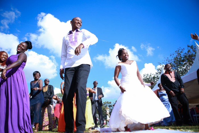 wedding photoshoot on a Helipad on top of nairobi's tallest building KICC with the skyline in view and sunset by waruisapix top kenyan wedding photographer-156