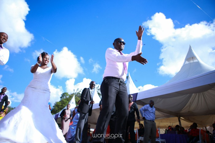 wedding photoshoot on a Helipad on top of nairobi's tallest building KICC with the skyline in view and sunset by waruisapix top kenyan wedding photographer-157