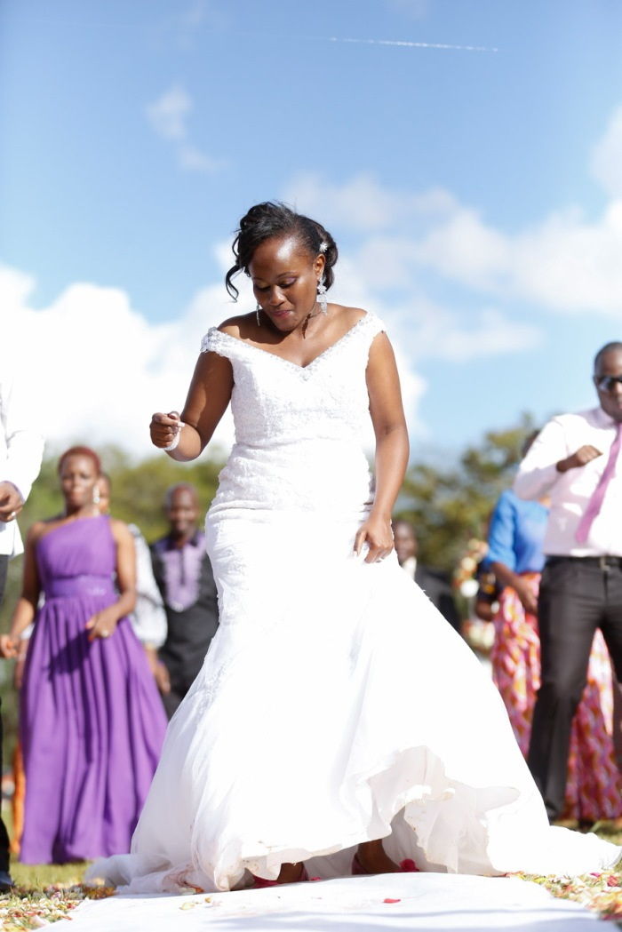 wedding photoshoot on a Helipad on top of nairobi's tallest building KICC with the skyline in view and sunset by waruisapix top kenyan wedding photographer-160