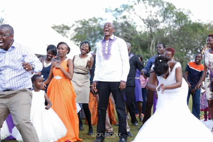 wedding photoshoot on a Helipad on top of nairobi's tallest building KICC with the skyline in view and sunset by waruisapix top kenyan wedding photographer-167