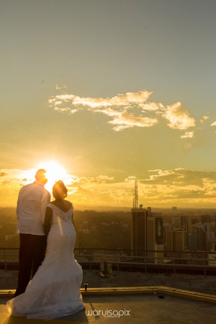 wedding photoshoot on a Helipad on top of nairobi's tallest building KICC with the skyline in view and sunset by waruisapix top kenyan wedding photographer-188