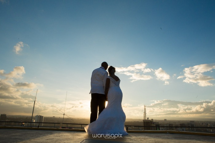 wedding photoshoot on a Helipad on top of nairobi's tallest building KICC with the skyline in view and sunset by waruisapix top kenyan wedding photographer-190