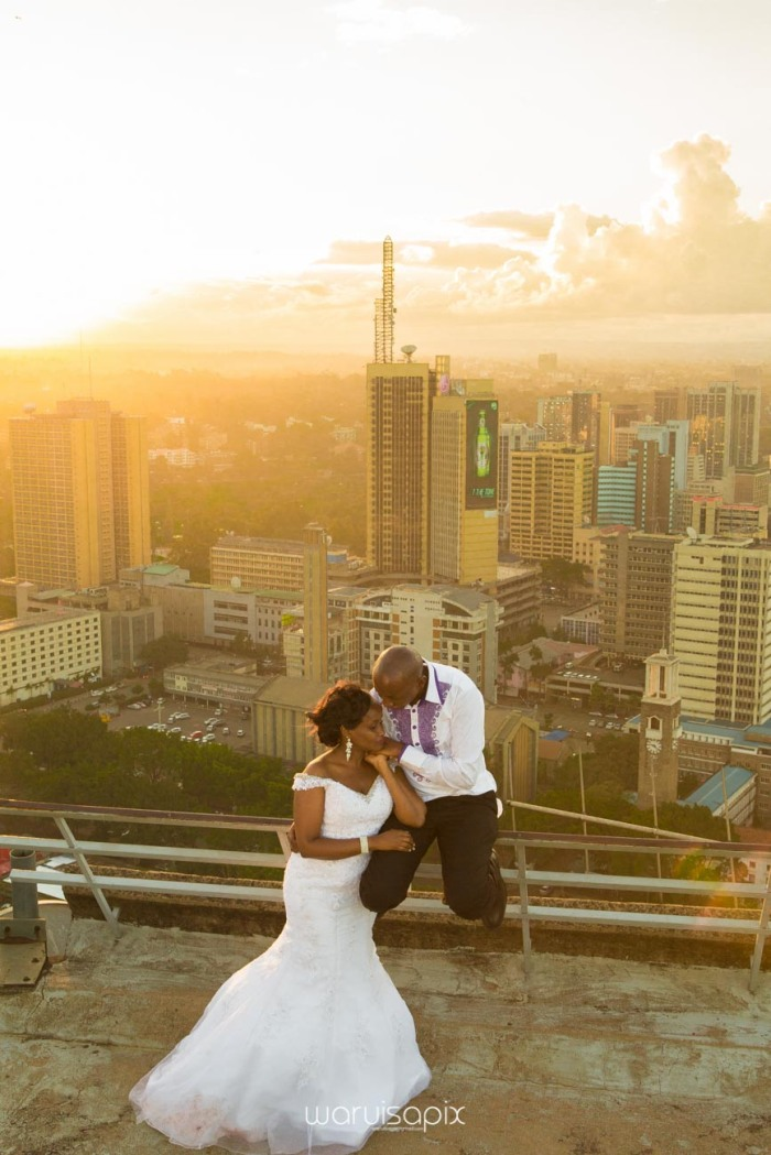 wedding photoshoot on a Helipad on top of nairobi's tallest building KICC with the skyline in view and sunset by waruisapix top kenyan wedding photographer-191