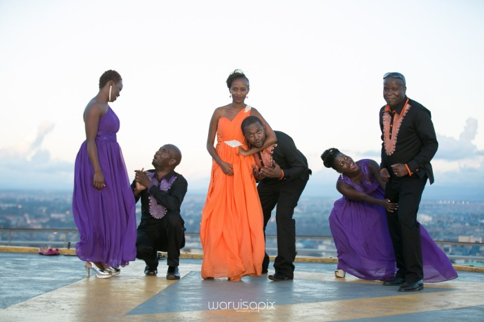 wedding photoshoot on a Helipad on top of nairobi's tallest building KICC with the skyline in view and sunset by waruisapix top kenyan wedding photographer-193