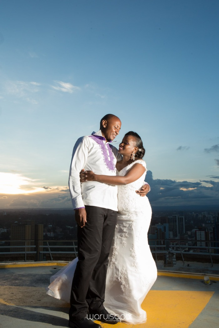 wedding photoshoot on a Helipad on top of nairobi's tallest building KICC with the skyline in view and sunset by waruisapix top kenyan wedding photographer-195