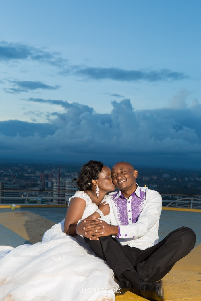 wedding photoshoot on a Helipad on top of nairobi's tallest building KICC with the skyline in view and sunset by waruisapix top kenyan wedding photographer-201