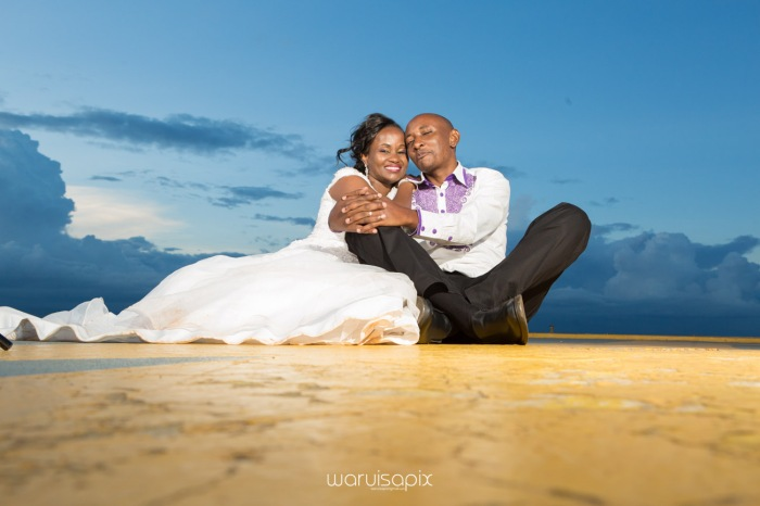 wedding photoshoot on a Helipad on top of nairobi's tallest building KICC with the skyline in view and sunset by waruisapix top kenyan wedding photographer-202