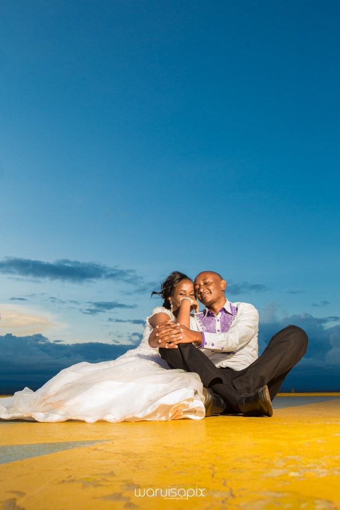 wedding photoshoot on a Helipad on top of nairobi's tallest building KICC with the skyline in view and sunset by waruisapix top kenyan wedding photographer-203