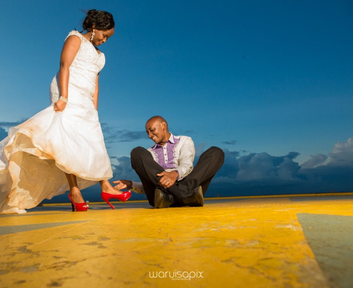 wedding photoshoot on a Helipad on top of nairobi's tallest building KICC with the skyline in view and sunset by waruisapix top kenyan wedding photographer-205