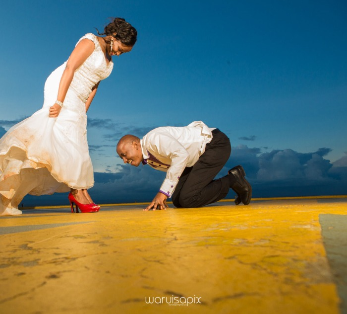 wedding photoshoot on a Helipad on top of nairobi's tallest building KICC with the skyline in view and sunset by waruisapix top kenyan wedding photographer-206