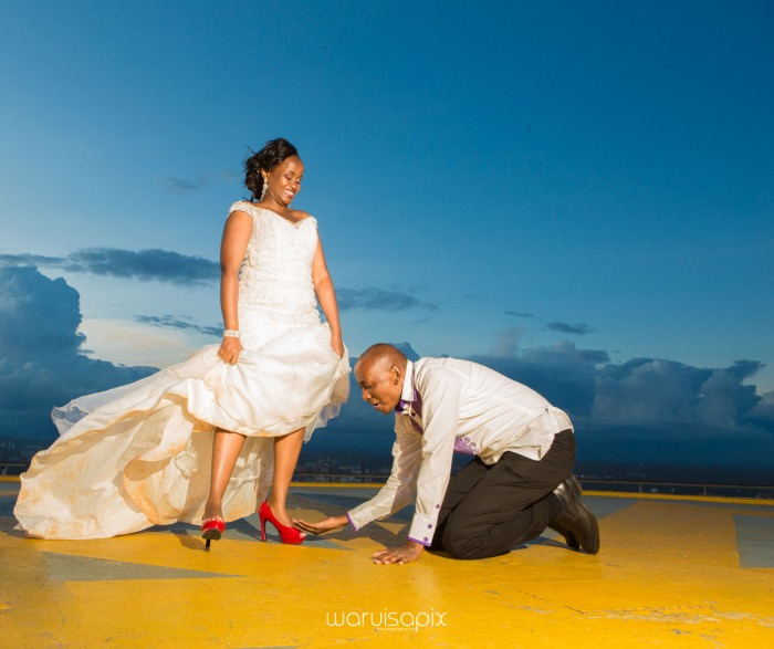 wedding photoshoot on a Helipad on top of nairobi's tallest building KICC with the skyline in view and sunset by waruisapix top kenyan wedding photographer-208