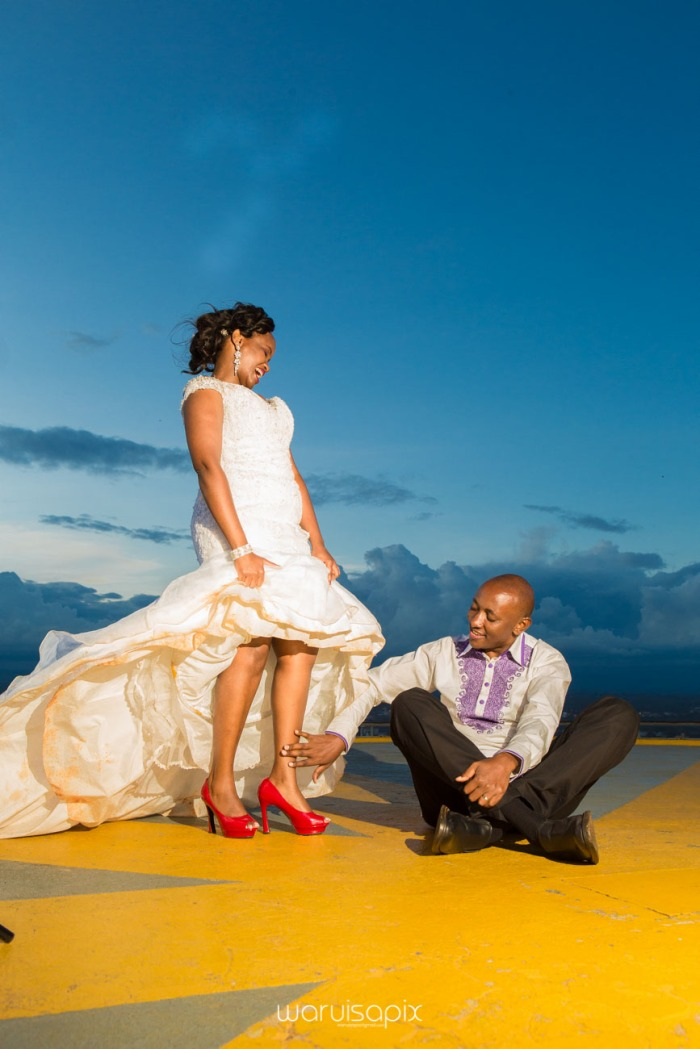 wedding photoshoot on a Helipad on top of nairobi's tallest building KICC with the skyline in view and sunset by waruisapix top kenyan wedding photographer-210