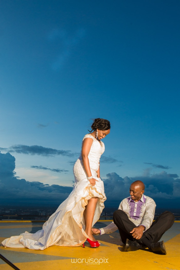 wedding photoshoot on a Helipad on top of nairobi's tallest building KICC with the skyline in view and sunset by waruisapix top kenyan wedding photographer-211