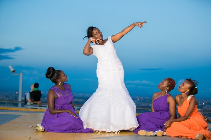 wedding photoshoot on a Helipad on top of nairobi's tallest building KICC with the skyline in view and sunset by waruisapix top kenyan wedding photographer-213