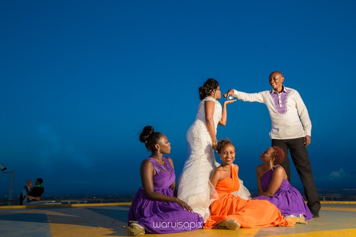 wedding photoshoot on a Helipad on top of nairobi's tallest building KICC with the skyline in view and sunset by waruisapix top kenyan wedding photographer-214