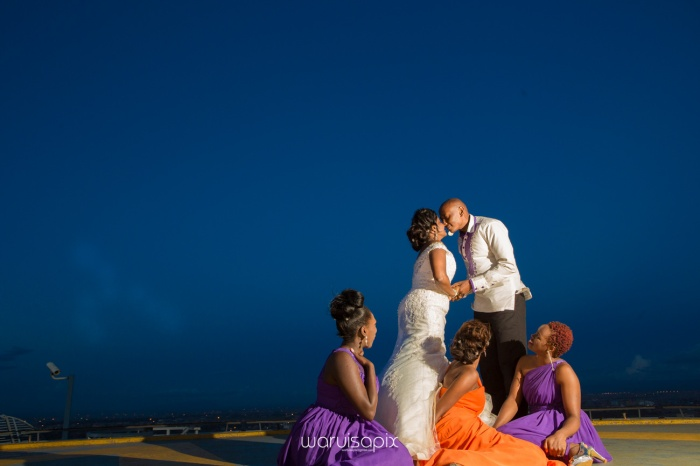 wedding photoshoot on a Helipad on top of nairobi's tallest building KICC with the skyline in view and sunset by waruisapix top kenyan wedding photographer-215